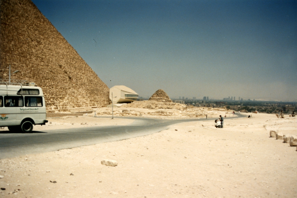 Pyramid of Cheops to the left, small white building is the solar boat museum