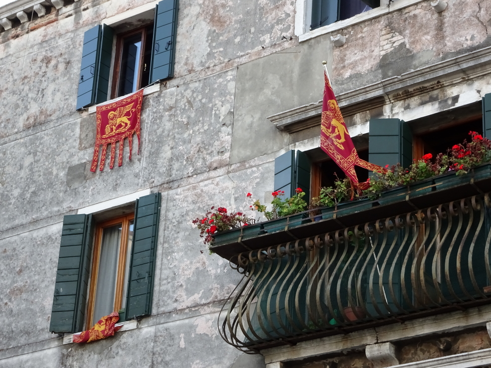 Venice banners flying from a window