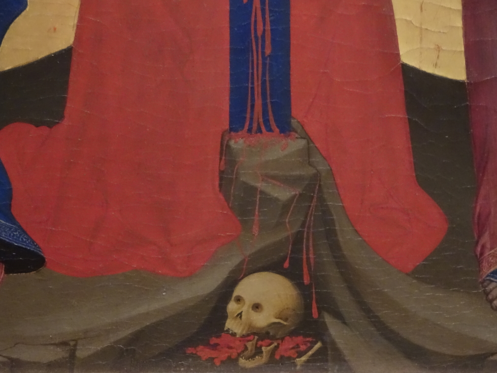 A common element of art at the time -- a skull at the base of the cross