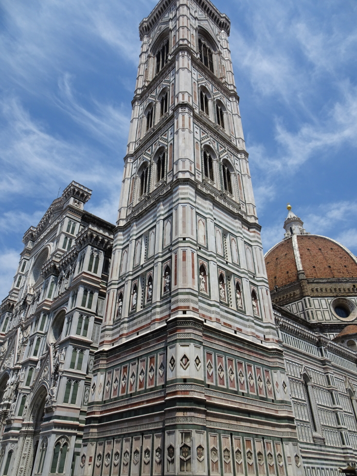 Campanile di Giotto with the entrance to the cathedral to the left and dome to the right