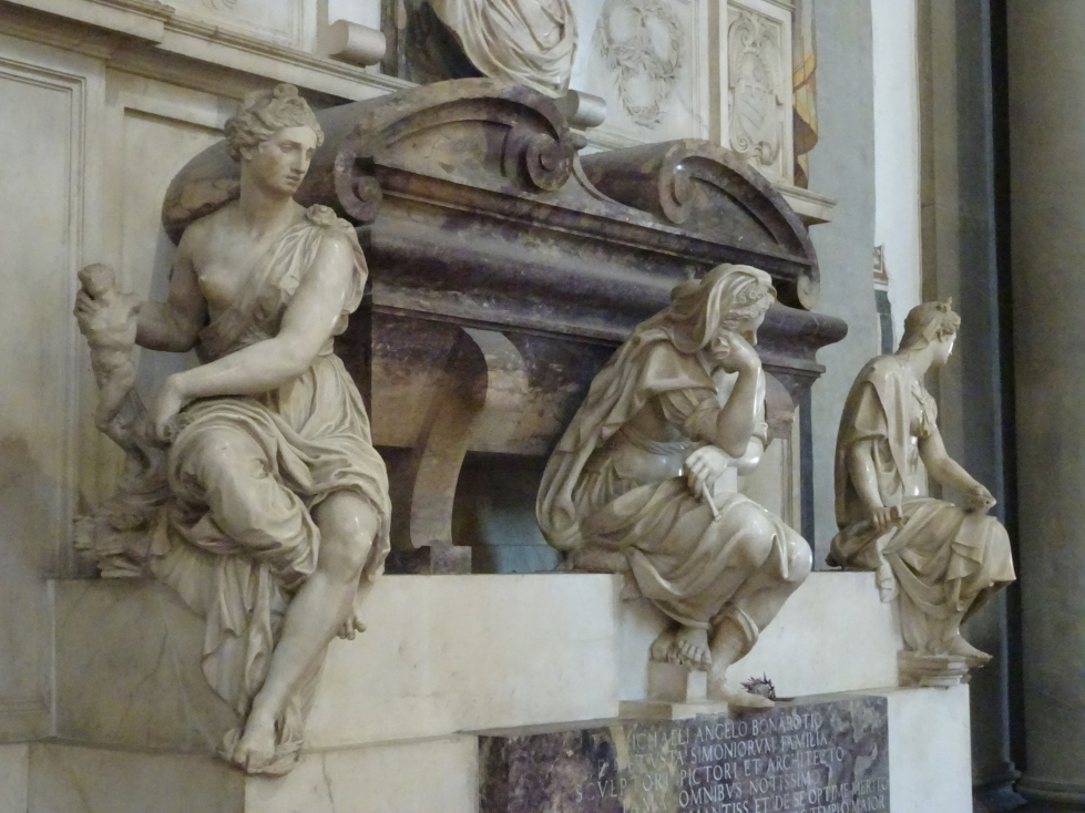 The three ladies, representing sculpture, painting, and architecture, surrounding Michelangelo's sarcophagus