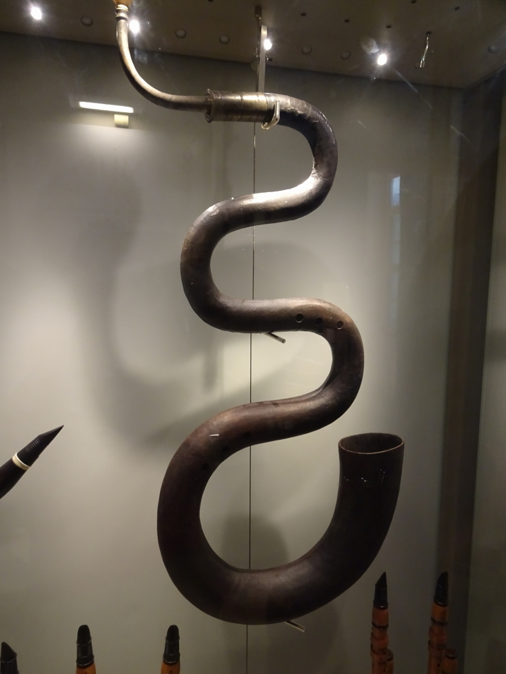 A serpent, an instrument that is an ancestor to the tuba