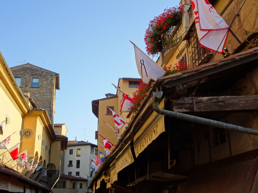 Flags lining the gold and jewelry stores of Ponte Vecchio