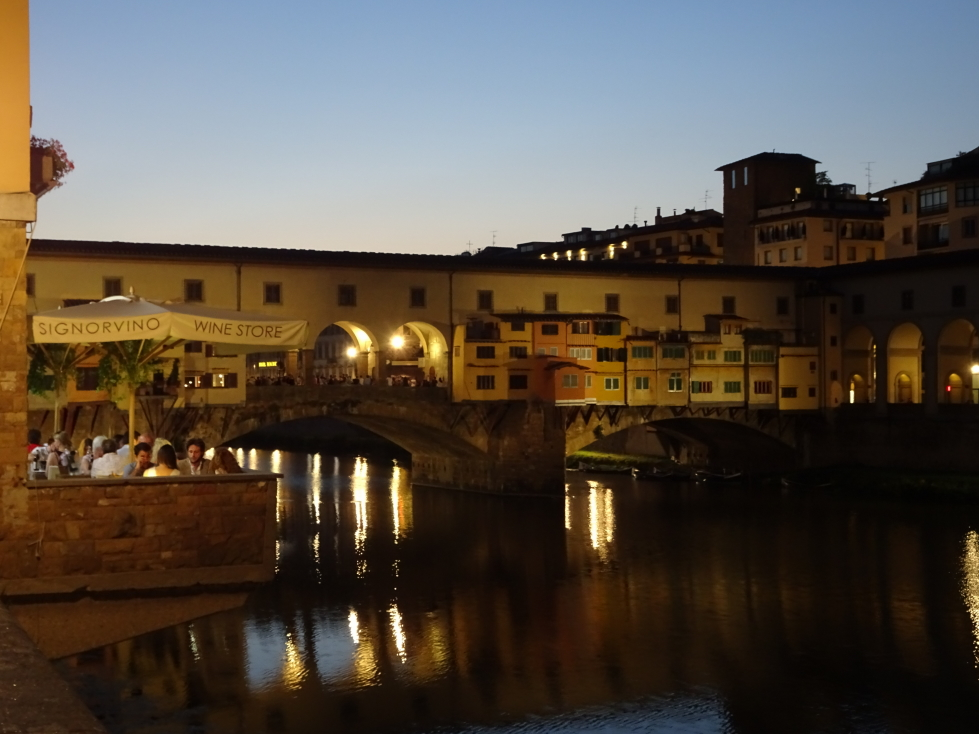 Ponte Vecchio at night from the Arno's south bank