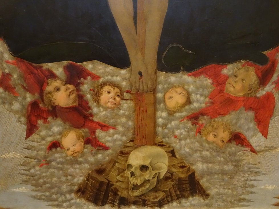 Creepy smiling skull with even creepier flying baby heads!