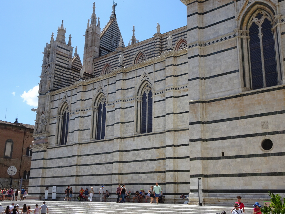 Side of Siena cathedral, note the white and black striped marble pattern