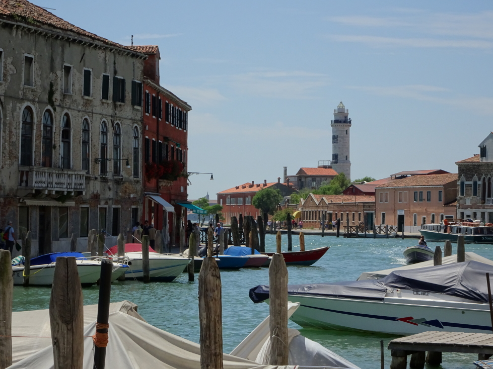 Looking down one of Murano's canal at its lighthouse, or Faro di Murano