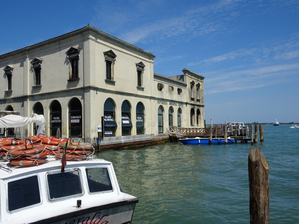 Glassmaking factory on Murano at the mouth of one of the canals