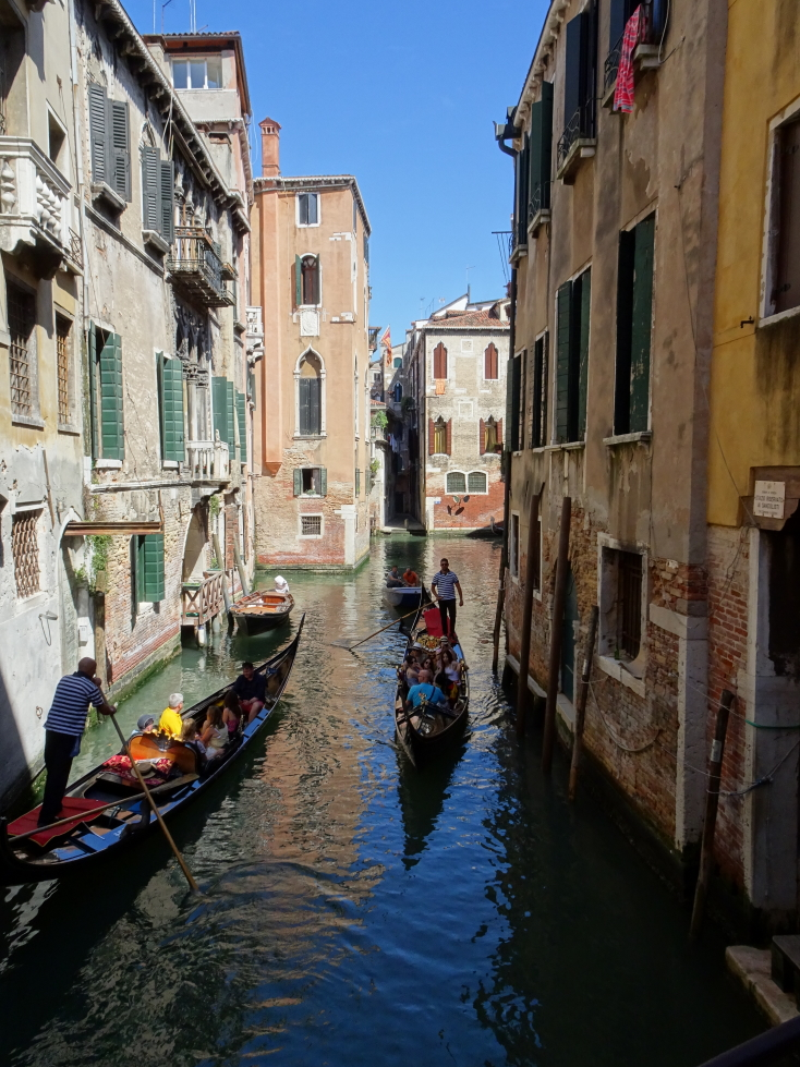 Canal with a couple of Gondoliers, Venice