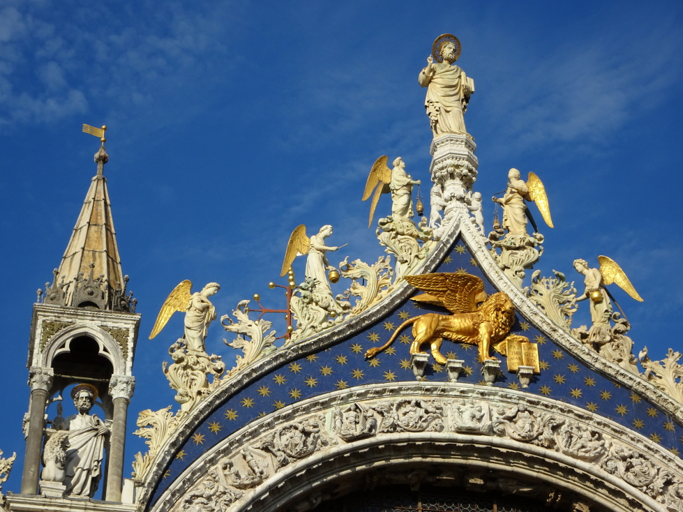 The symbol of Venice, the golden winged lion, was striking against the blue background