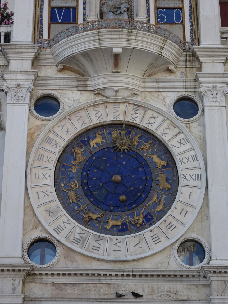 Detail of the Torre dell'Orologio, note the roman hour and Arabic minute