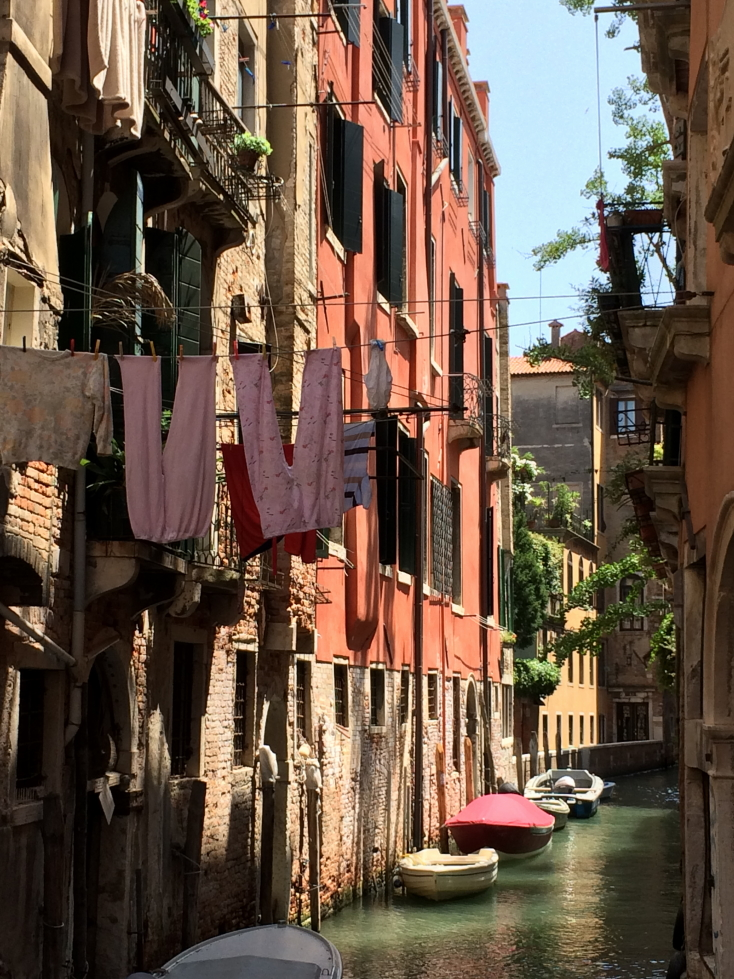 Laundry hanging across a canal in Venice