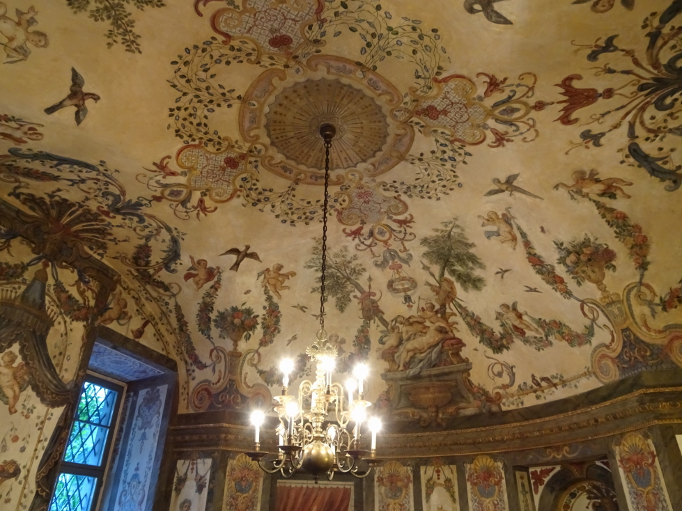 Chandelier and painted ceiling at the Mozarthaus