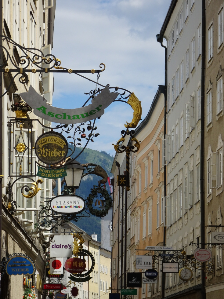 A visual cacophony of shop signs in Salzburg