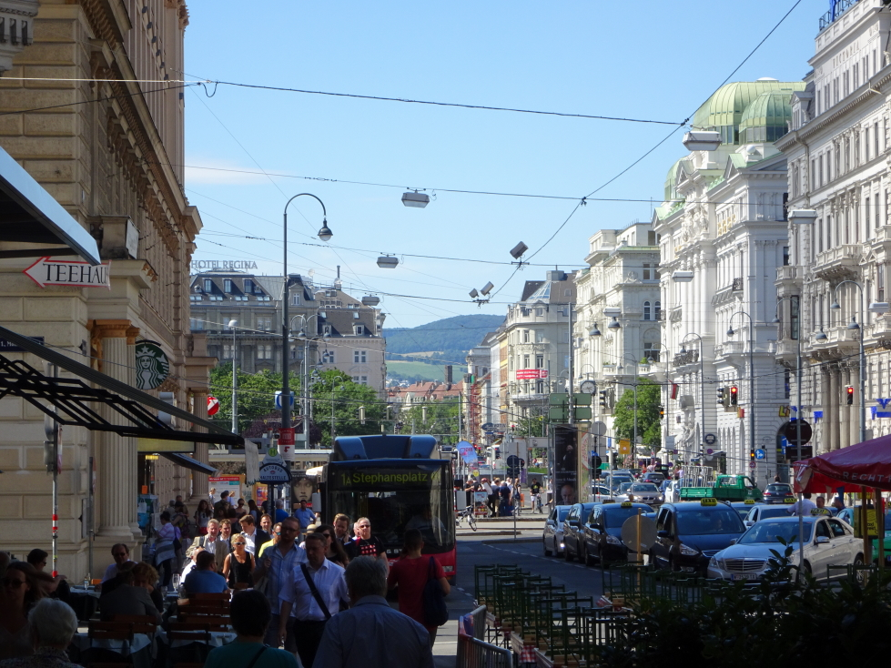 View of a main street in Vienna with hills beyond