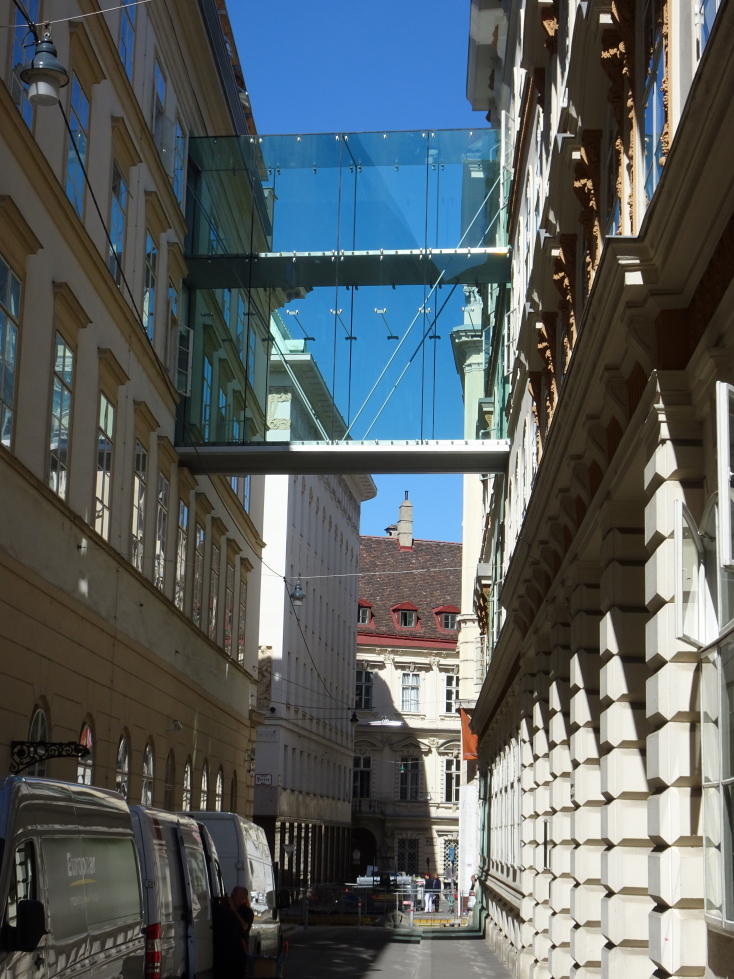 A nearly all-glass walkway over the street. Nope, nope, nope